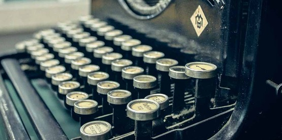 keys of an old manual typewriter; newsletter,