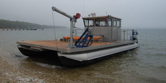 """The Shellstar"" is the Scallop Program's custom built pontoon barge."