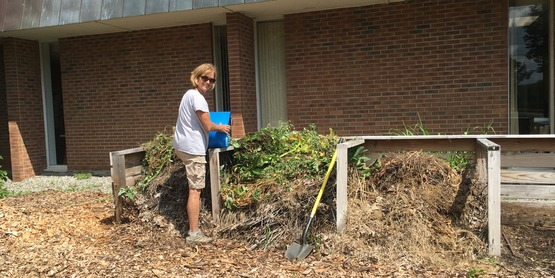 MG Kathy Smith works on CCEDC compost pile