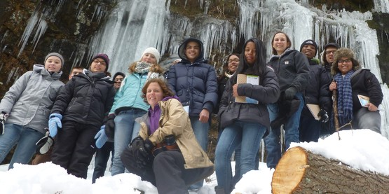4-H Program Leader and youth on a snowy hike.