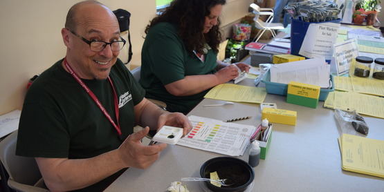 Master Gardeners testing soil for pH at their annual Garden Day event