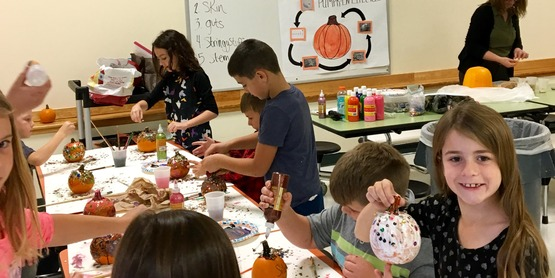 Beaver River afterschool students learn about the parts of a pumpkin.