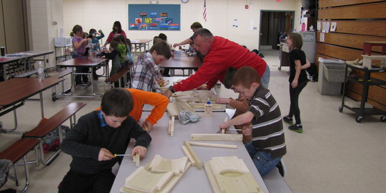 Mr. Rudy teaches woodworking to the 4-H afterschool students.