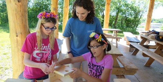 Youth constructing bird nest boxes for Ornithology research