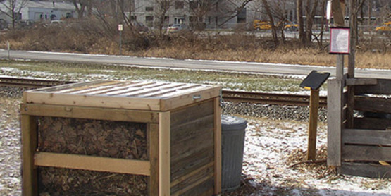 "A single ""compost knox"" bin at the Ithaca Community Gardens. Members weigh food scraps with the scale provided and log their scraps in the log book."