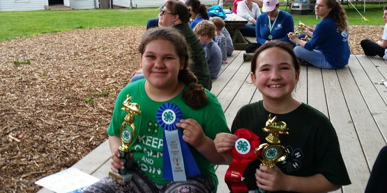 Ava and Molly with trophies.