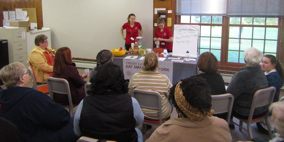 ESNY educators Aprylle Deasey and Shelby Taylor share nutrition tips with attendees.