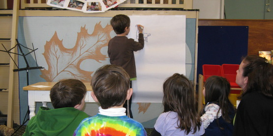 "Jake Paradisin, age 7, shares his public presentation on ""How to Draw a Dragon"" at a Namaste Friends 4-H Club Meeting , 2010"