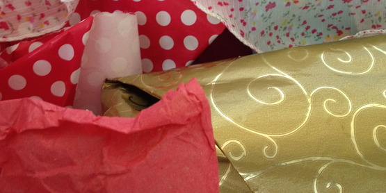 The best thing you can do with wrapping paper is remove it and put it away to reuse.