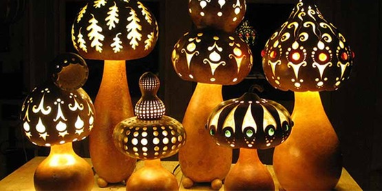 Carved gourd lamps made by Gourlandia