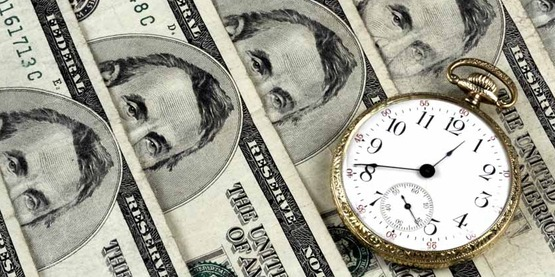 currency; five dollar bills and a pocket watch; money