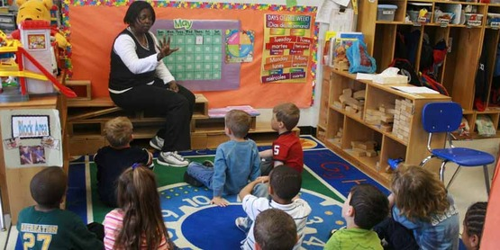 Teacher teaching students in an early childhood setting.
