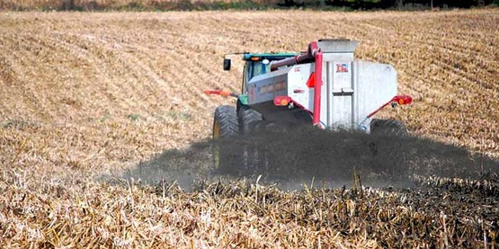 Spreading liquid manure on a harvested corn field