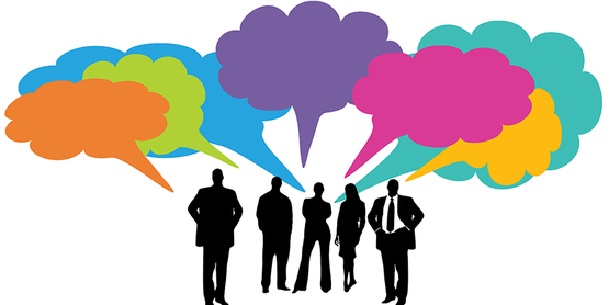 group of business people in silhouette with multi colored speech bubbles