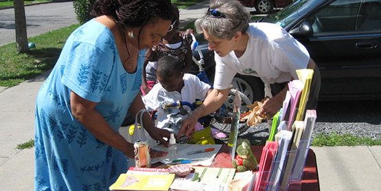 Nancy Potter (right) tabling at a housing project event