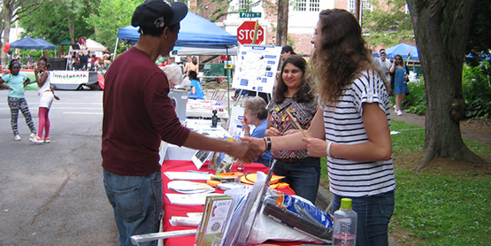 tabling at Juneteenth; Gibrian Hagood (left) with CCE interns Abby Yatsko (right) and (unknown)