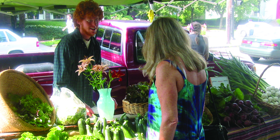 Customer and vendor at DeWitt Farmers' Market, Ithaca NY (2008)