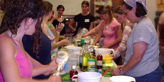 Nutrition Program Educator Myra McKinney (center) leads a hands-on cooking class at CCE-Tompkins (2007)
