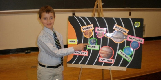 Youth giving presentation about planets