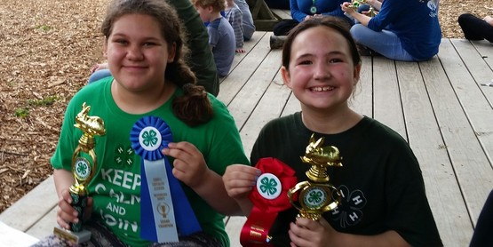 4-H youth with trophies.