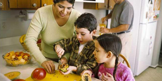 A family prepares fruit salad
