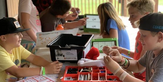 Camp Kids with Robots Kits