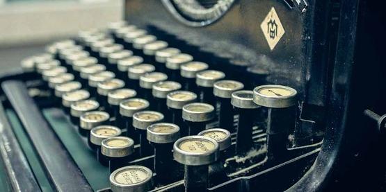 keys of an old manual typewriter; newsletter,