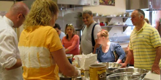 A Cooking Matters class in the Cargill Teaching Kitchen at CCE-Tompkins with participants from Finger Lakes Independence Center (June 2012)