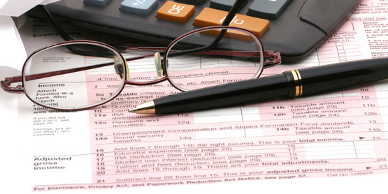 tax return, eye glasses, calculator