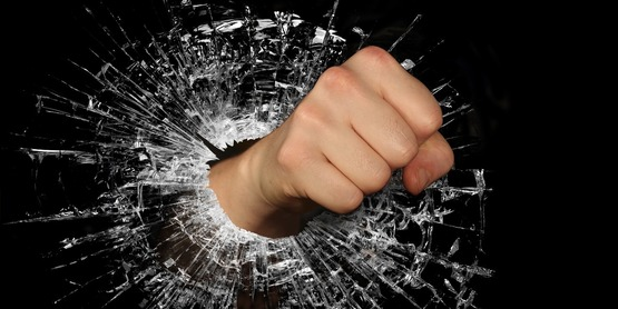 a fist punching through glass