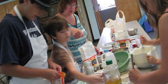 "Family members make a meal together during a ""Cooking Together for Family Meals"" class in Groton, NY, coordinated by CCE-Tompkins and Groton's Families! program (May 2010)."