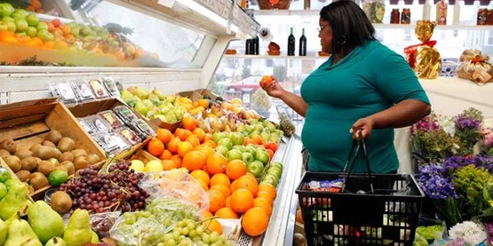 Woman choosing fruit in the supermarket; shopping; UConn Rudd Image Library, Image #273, nonprofit use is permitted