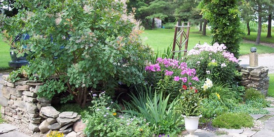 Landscaping with flowers, trees, shrubs, and vegetables.