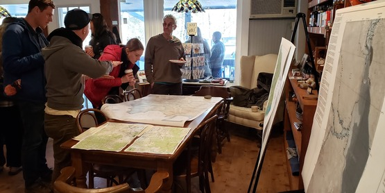 Participants in the 2019 Stream Map Event look over a map at Marty's Mercantile in West Shokan