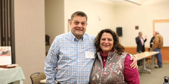 outgoing bord president cathi annese and new board president billy greere