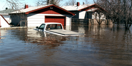 Water from the Red River swept into the Grand Forks area, flooding homes, submerging cars and destroying property on a massive scale (4/01/1997).