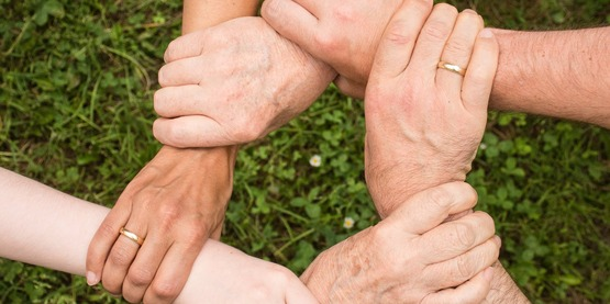 family holding hands in group