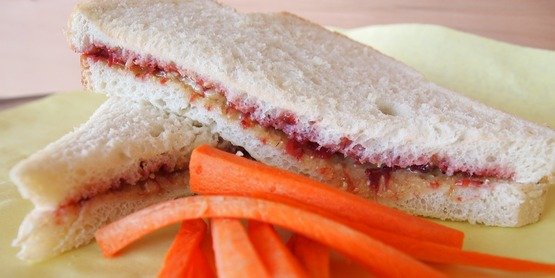 peanut butter and jelly sandwich with carrot sticks