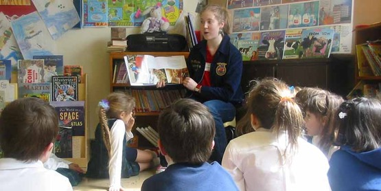 A volunteer reads to a group of 2nd graders in Tompkins County during Ag Literacy Week 2006. Ag-in-the-Classroom