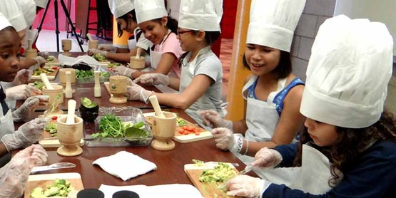 children cooking in Coqui the Chef Nutrition Workshop Building Healthy Habits. Bronx NY