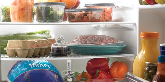 Raw meat, poultry, and seafood should be in a sealed container or wrapped securely to prevent raw juices from contaminating other foods.