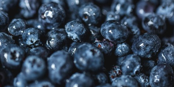 Close up of freshly washed blueberries.