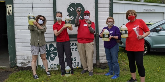 CCE staff gives sanitizer and masks to farmers