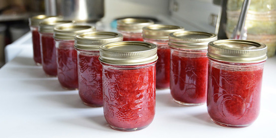 strawberry jam in glass pint canning jars