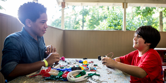two boys do STEM activity