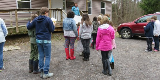 4-H educator introduces activity to youth at the 4-H Amboy Environmental Education Center