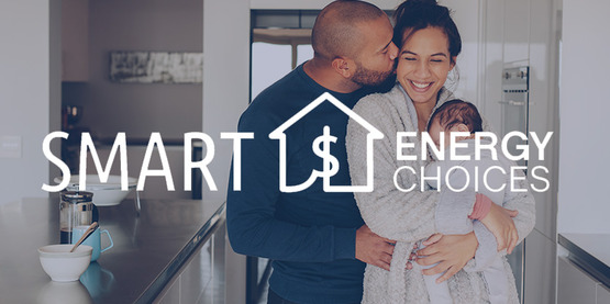 couple with baby in kitchen of home