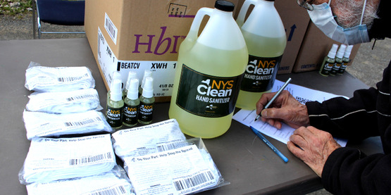 An ag producer completes paperwork to sign out sanitizer and masks distributed by the NYS Departments of Ag & Markets in response to Covid-19