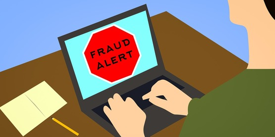 a cartoon of a laptop with fraud alert written across it