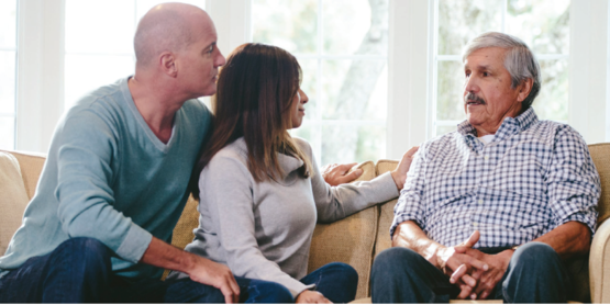 Dementia conversations photo from flyer. An aging adult man sitting with two people.